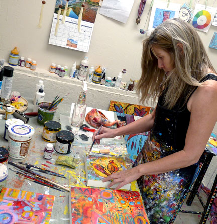 L. Gruger painting in studio
